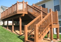 Cabot cedar tone solid color oil stain on a deck.